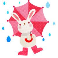 雨の日に、赤い水玉の傘をさした、うさぎの無料イラストです。