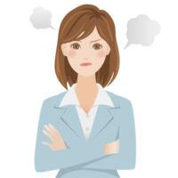 腕を組んで怒っているスーツを着た若い女性のイラスト