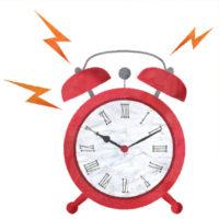 ジリジリなっている目覚まし時計のイラストです