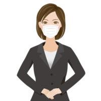 マスクをしている、黒いスーツを着たキャリアウーマン風の女性の無料イラストです。